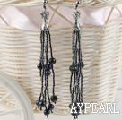 sparkly black pearl and tassel earrings