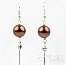 Wholesale Dangle style brown round seashell earrings with long tail