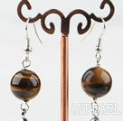 Dangle style round tiger eye earrings with long tail