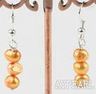 dyed orange pearl earrings