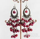 red pearl dangling style earrings