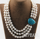 sparkly three strand white baroque pearl necklace with blue gem clasp