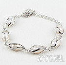 Fashion Style Rice Shape White Freshwater Pearl Metal Bracelet with Adjustable Chain