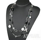 long style white crystal and black agate and howlite necklace with metal loop