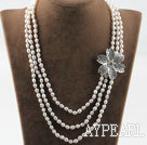 Wholesale Three strand rice shape freshwater pearl necklace with flower accessories