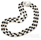 3 strand white pearl and black crystal necklace
