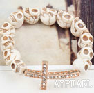 Golden Color Rhinestone Sideway/Side Way Cross and Howlite Skull Stretch Halloween Bracelet