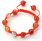 färgad orange skal armband