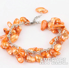 irregular shape dyed orange pearl bracelet with extendable chain