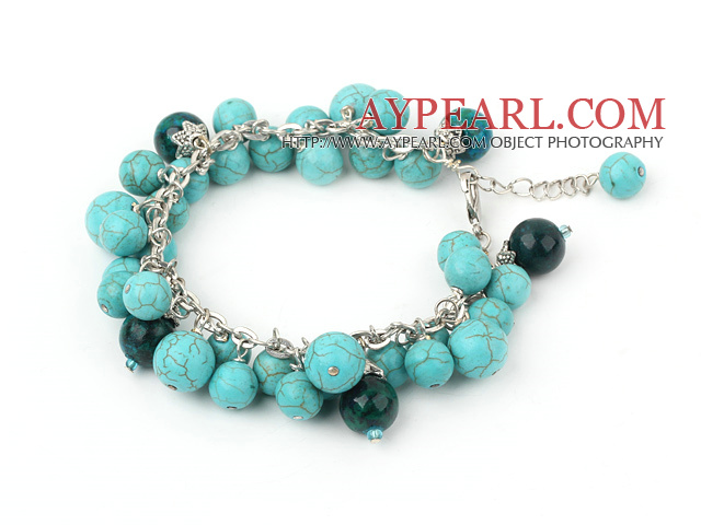phoenix stone and burst pattern turquoise bracelet with metal chain and lobster clasp