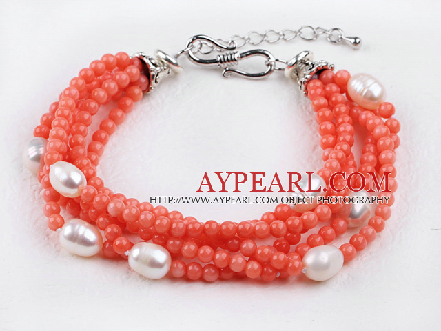 multi strand orange coral and white pearl bracelet with extendable chain