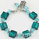 green colored glaze and  crystal bracelet with toggle clasp