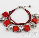 red colored glaze and fish charm bracelet with extendable chain
