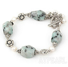 Wholesale white pearl and spot stone bracelet with toggle clasp