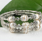 Multi strand white freshwater pearl metal bangle bracelet