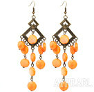 Vintage Style Rhombus Shape Accessory and Flat Round Orange Shell Long Earrings