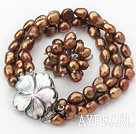 8-9mm Brown barokk Freshwater Pearl Set med Shell Flower Clasp (Strands armbånd og ring)