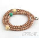 Faceted Sun Shone Beaded Stretch Bracelet with Corozo Nut Buddha's Head and Turquoise and Sterling Silver Elephant Accessory ( Can also be Necklace )