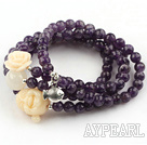 Faceted Amethyst Beaded Stretch Bracelet with Corozo Nut Buddha's Head and Rose Flower and Sterling Silver Fish Accessory ( Can also be Necklace )
