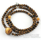 Tiger Eye Beaded Stretch Bracelet with Wax Buddha's Head and Yellow Jade and Sterling Silver Fish Accessory ( Can also be Necklace )