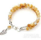 Two Rows Golden Color Mother of Pearl Bracelet with Silver Leaf Shape Accessory and Clasp