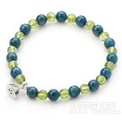 Single Strand Kyanite and Peridot Beaded Stretch Bangle Bracelet with Silver Lotus Seedpod Accessory