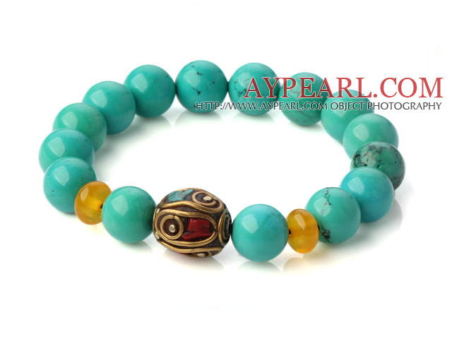 Popular Xinjiang Green Turquoise And Beeswax Beads Stretch Bracelet With Tibetan Charm