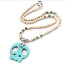 Wholesale White Series White Howlite Necklace with Green Turquoise Skull Pendant