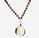 Wholesale Obsidian Beads and Agate Necklace with Corozo Nut Laugh Baddha Pendant and Silver Beads