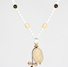 Wholesale White Porcelain Stone and Black Agate Necklace with Corozo Nut Laugh Baddha Pendant