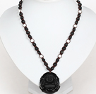 Wholesale Obsidian Beads and White Porcelain Stone Necklace with Laugh Baddha Pendant