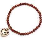 beautiful round goldstone and tibet silver peach heart charm beaded bracelet