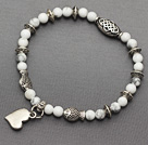 soft round white turquoise and multi tibet silver fish heart charm beaded bracelet