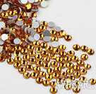 Rhinestone cabochon, golden, silver-foil back ,3.0-3.2mm faceted round, SS12. Sold per pkg of 1440.