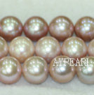 Freshwater pearl beads, purple, 10-11mm round. A grade. Sold per 15.7-inch strand.