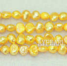 Freshwater pearl beads, dyed yellow, 5-6mm potato. Sold per 14-inch strand.