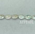 Freshwater pearl beads, white, 10-11mm oval coin. Sold per 14.8-inch strand.