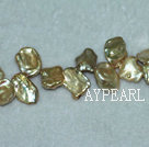 Freshwater pearl beads, golden, 5*11*13mm top-drilled keshi. Sold per 15-inch strand.